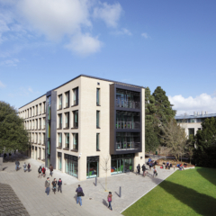 Photograph of the Alison Richard Building with people walking past.